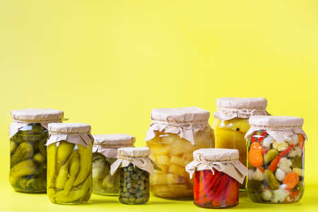 Preserved and fermented food. Assortment of homemade jars with variety of pickled and marinated vegetables on a table. Housekeeping, home economics, harvest preservation