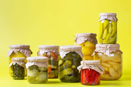 Preserved and fermented food. Assortment of homemade jars with variety of pickled and marinated vegetables on a table. Housekeeping, home economics, harvest preservation 写真素材 - 154897423