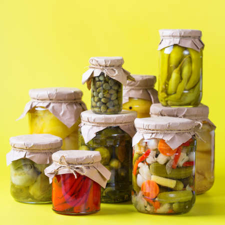 Preserved and fermented food. Assortment of homemade jars with variety of pickled and marinated vegetables on a table. Housekeeping, home economics, harvest preservation 写真素材 - 154897319