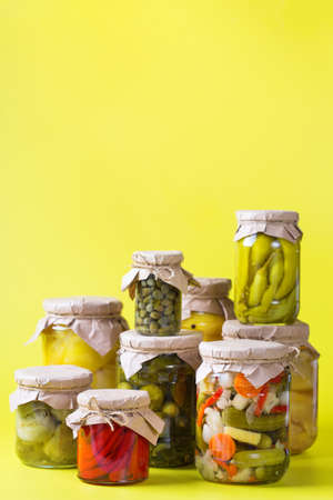 Preserved and fermented food. Assortment of homemade jars with variety of pickled and marinated vegetables on a table. Housekeeping, home economics, harvest preservation 写真素材 - 154898871