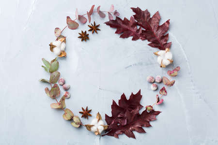 Creative autumn fall thanksgiving day composition with decorative dried leaves. Flat lay, top view, copy space, still life pastel background for greeting card