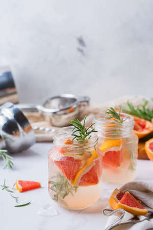 Hard seltzer cocktail with grapefruit and rosemary