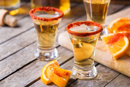 Mexican mezcal or mescal shot with chili pepper and orange Standard-Bild