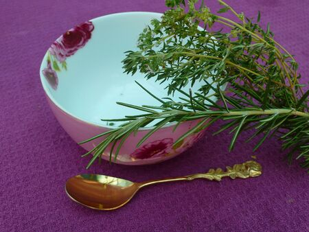 Bowl with herbs for tea on table, interior