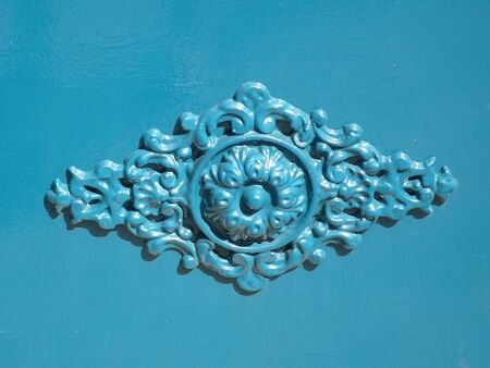 metal blue ornament on a door, in France