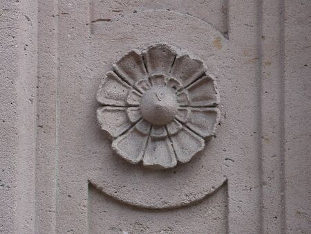 embossed concrete floxer on a door, in France