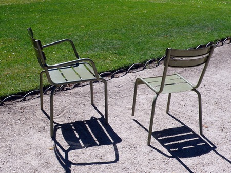 couple of chair in a park, in France Stock Photo