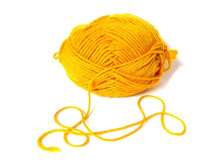yaw: yellow ball of wool, on white background