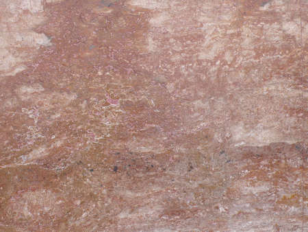 edifice: wall made from red marble, in an edifice