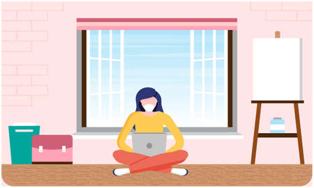 woman is sitting on the ground and working on laptop at home