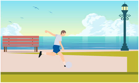 man is playings football on the beach