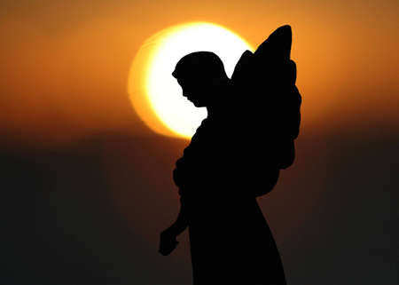 Silhouette of a Statue of an Angel  Stock Photo - 5317734