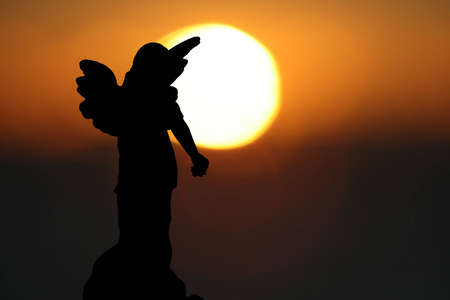 headstones: Silhouette of a Statue of an Angel  Stock Photo