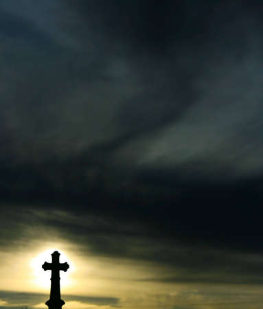 Background a  Silhoutette of a Cross at Sunset photo
