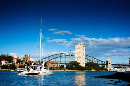 Yacht in front  of Sydney Harbor (Harbour) Bridge Stock Photo