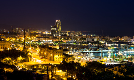 Night view of Barcelona Port Vell, Port Olimpic, Mirador de Colom from Montjuic hill, Catalonia Editorial