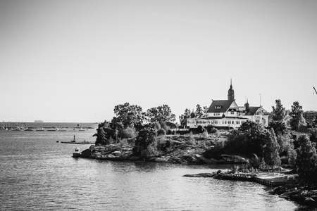 Island with house, cottage or villa on Islands of Sweden in b w
