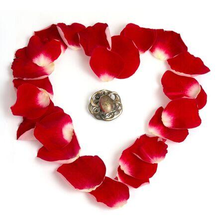 Brooch inside rose petals heart