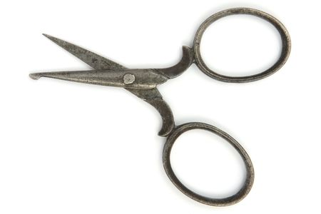 Ancient open scissors  on white background