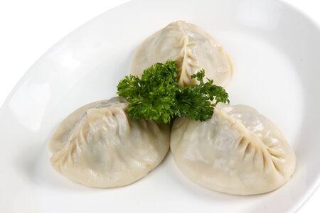 Oriental meat dumplings with parsley
