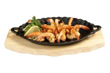 Shrimp grill on metallic dish and wood board    Stock Photo