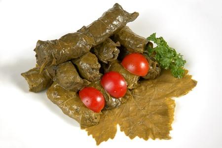 Dolmades (sarma, dolmadakia) on grape leaf    Stock Photo