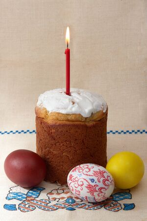 Easter cake with eggs and candle