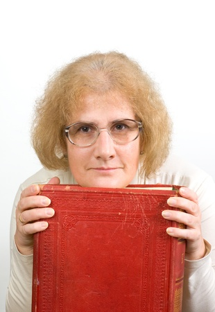 Senior woman holding old book/Bible