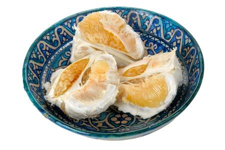 Pomelo fruit on blue ornament dish