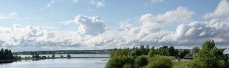 Summer landscape with lake Paskoe and village Ferapontovo, Vologda  region, Russia  Stock Photo