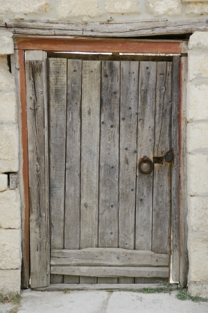 Ancient wooden door  in Chufut Kale fortress in Crimea near Bakhchisaray  Stock Photo