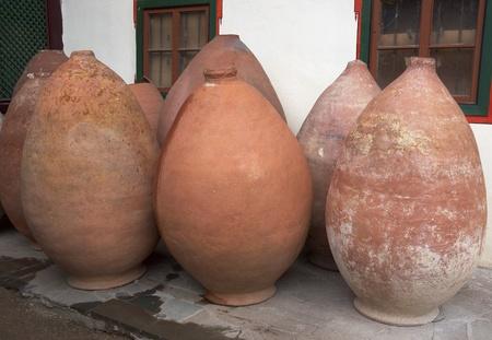 Antique pitchers for the oil, salt in amphoras form