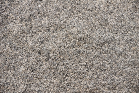 Surface of natural  gray spotted stone as background photo