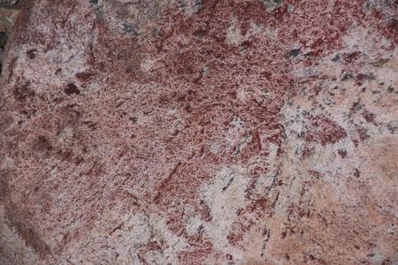 quartzite: Surface of natural  dark red stone  crimson quartzite porphyry  as background