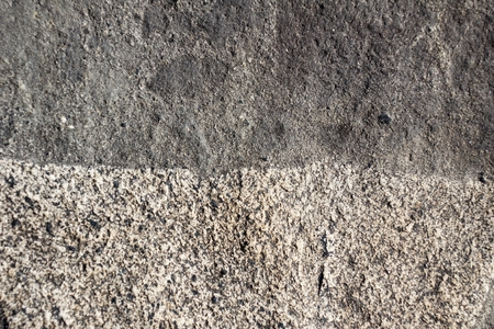 Boundary of two surfaces of natural  gray spotted stone Stock Photo