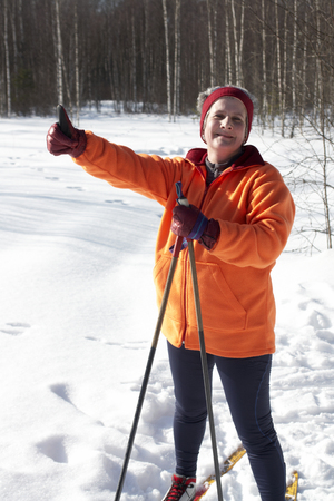 Female cross country skier gives the thumbs up sign                                photo