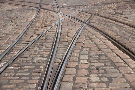 Tram tracks on cobblestone road photo