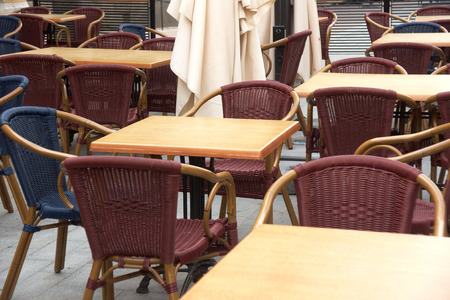 Tables and chairs in cafe on street Stock Photo