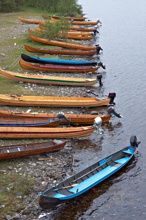 Motor boats on river bank in Norway