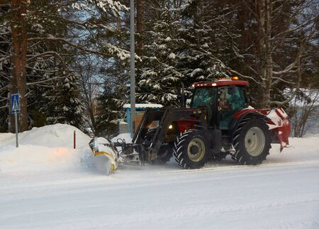 Snowblower in country winter street