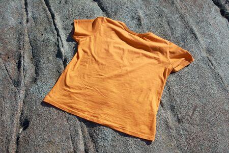T-shirt on a rock stone Stock Photo