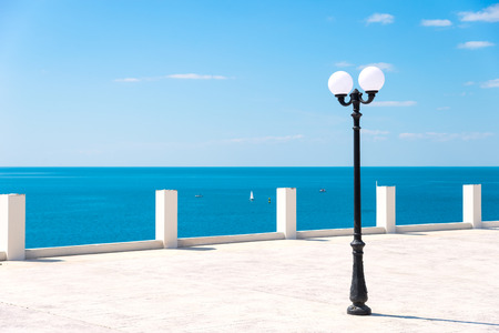 Street lamp on the sea promenade on clear sunny day Stock Photo