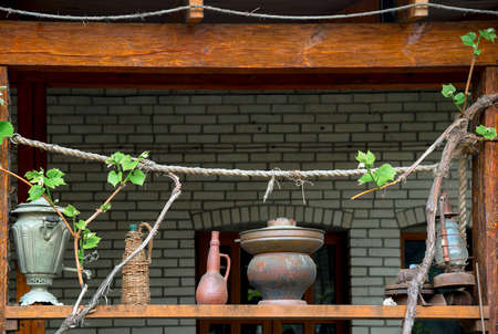 Old subjects on terrace of house with grapes