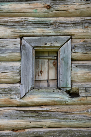 Very old small window of rural wood house