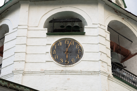 Clock on the dial that instead of numbers placed Slavonic letters. Cathedral bell tower of the Suzdal Kremlin. Town Suzdal, Vladimir region, Russia Stock Photo