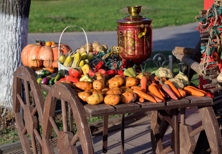 Showcase of artificial vegetables with samovar in cart
