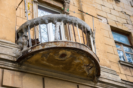 Old ruined balcony with a rope and clothespins. Rostov-on-Don, Russia
