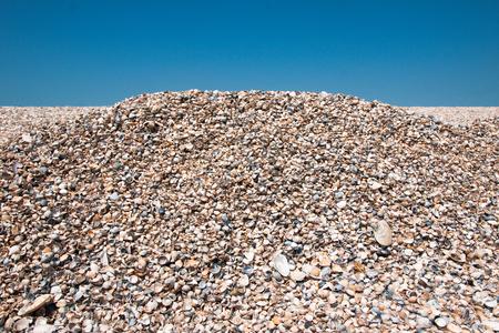 Shell beach on sky background