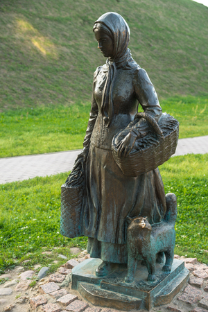 Sculpture of commoner girl with basket and cat, Dmitrov, Moscow region, Russia Stock Photo