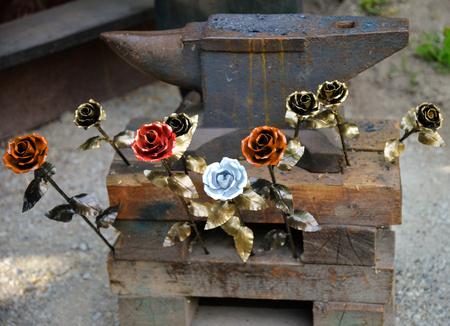 Colored metal rose on anvil
